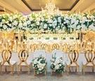 wedding reception gold chairs flower bride groom chairs tall centerpiece chandelier modern gold