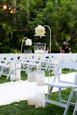 Outdoor ceremony aisle decoration with white hook