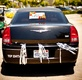 Chrysler 300 with silver streamers and Just Married sign