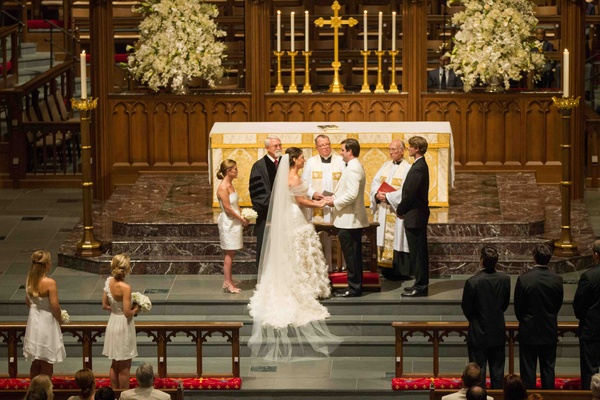 White and gold decorations at church wedding