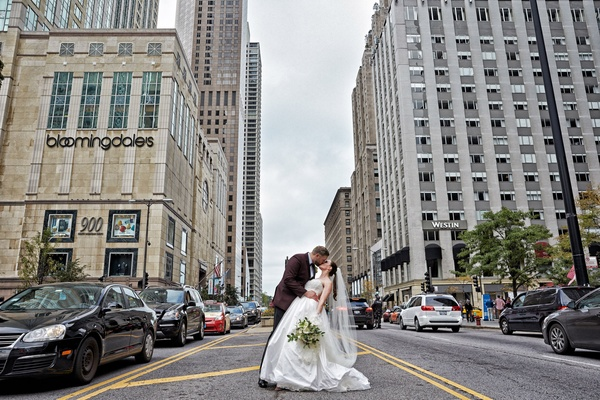 Bride and groom share kiss in Chicago in the middle of Michigan Avenue