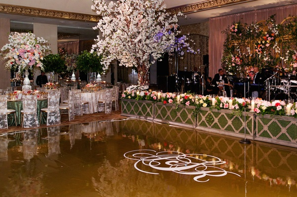 Hedge-lined entertainment stage and monogram floor