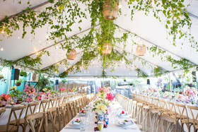 elegant rehearsal dinner with natural decor, tented rehearsal dinner with greenery and basket lights