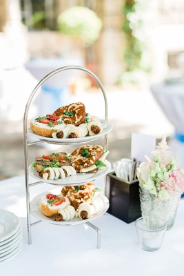 wedding ceremony cocktail hour three tier tea stand tea sized sandwiches and german food