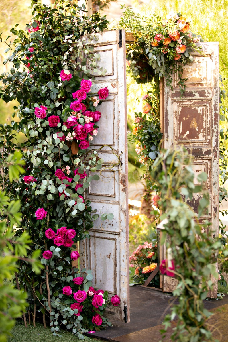 wedding reception ceremony decor wood doors with pink roses greenery flowers decor outdoor