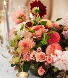 wedding reception centerpiece pink burgundy dahlia flowers roses greenery hydrangea