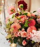 wedding reception centerpiece pink burgundy dahlia flowers roses greenery hydrangea