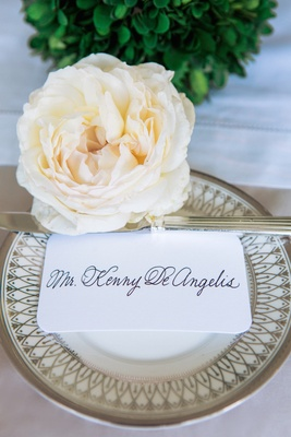 Rounded edge seating card with calligraphy and fresh rose