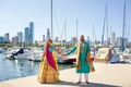 pakistani couple in traditional attire hold hands on dock in chicago