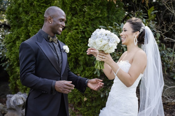 NFL Tennessee Titan gets first look at his bride in a Mark Zunino dress