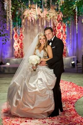 Bride in princess dress and groom in indoor garden