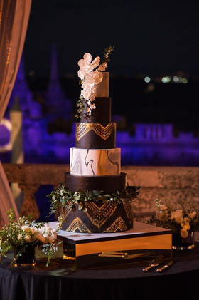 six-tier wedding cake, black and gold tiers, marble tier, sugar flowers