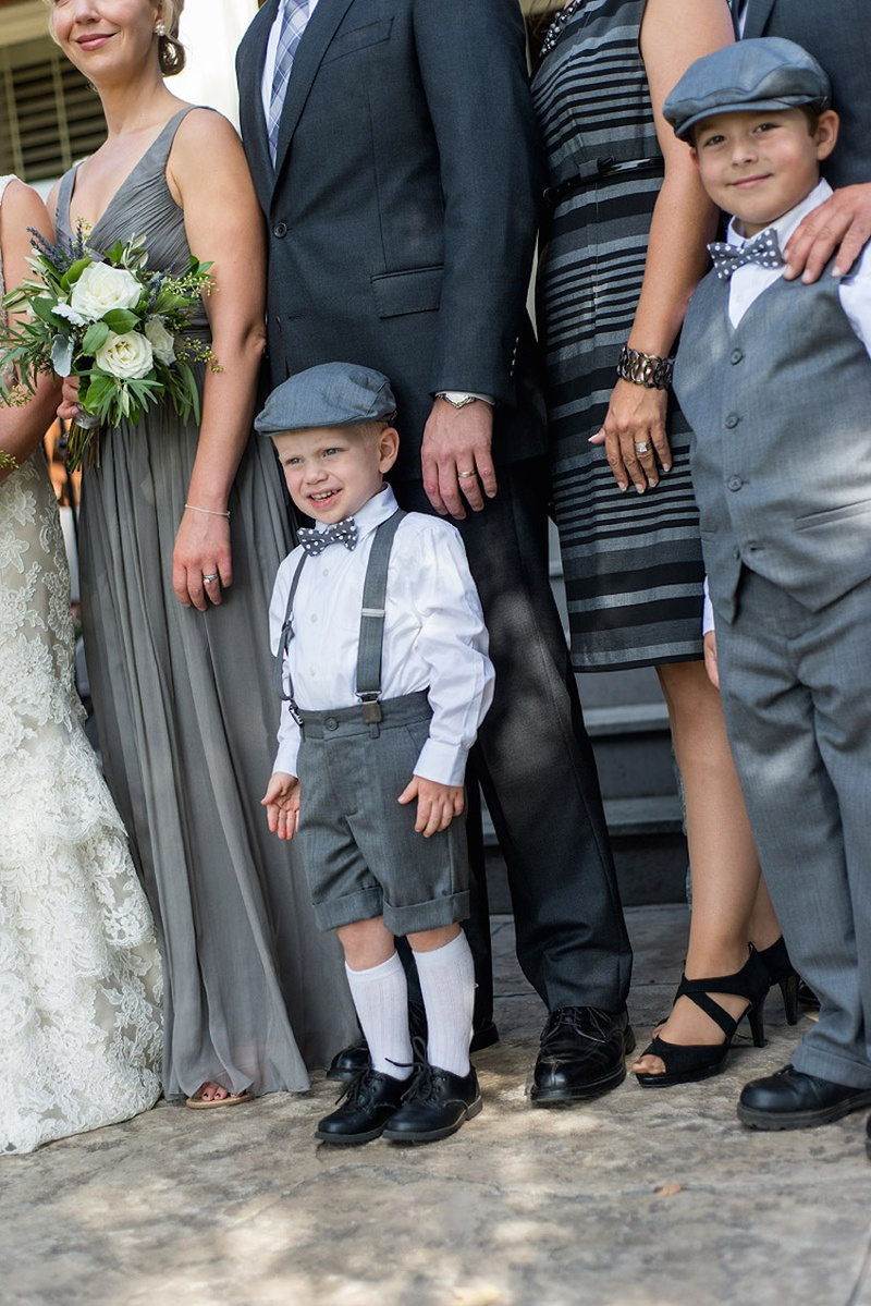 Young blond boy in ring bearer outfit and newsie cap