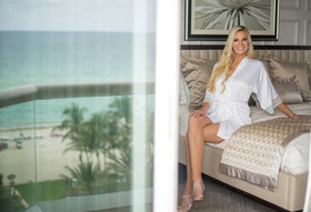 wedding photo of bride in white robe high heels long blonde hair acqualina resort and spa florida