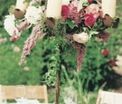 Individual centerpiece with flowers and candles