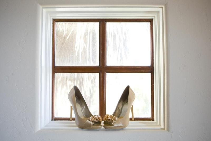 Bride's taupe peep-toe heels with ruffle tops