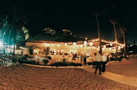 Beach venue open to the sand lit with paper lanterns