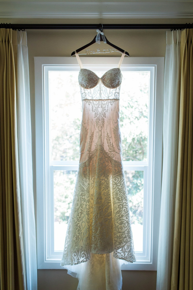 lace flared gown hanging up berta designer fit and flare trumpet