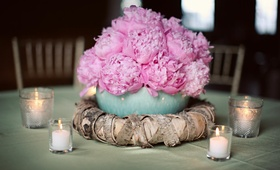 small arrangement of peonies in blue bowl