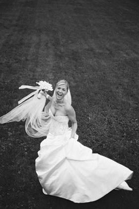 Bride wearing strapless embroidered bodice wedding dress