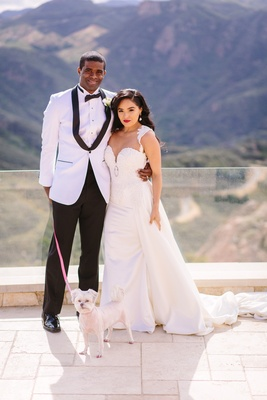 bride in riki dalal couture, detachable train on sheath gown, groom in white jacket caravelli, dog