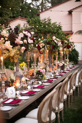 wedding reception outdoor long table wood cane chair tall centerpiece fall wedding ideas greenery
