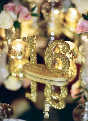 Gold glitter number 16 table marker on mirror top reception table wedding ideas