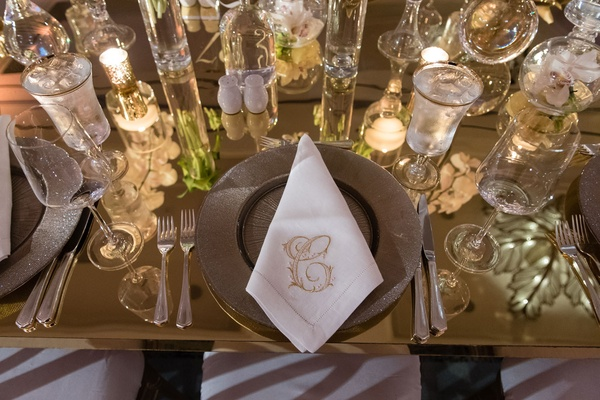 Wedding guest place setting with candles glassware monogram napkin stitch C letter initial