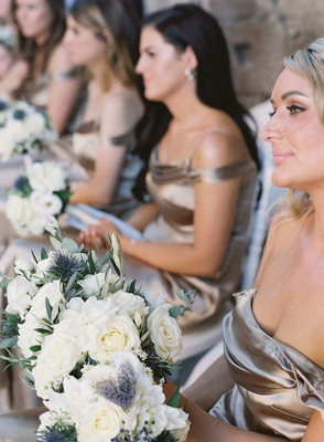 wedding ceremony in italy bridesmaids in metallic champagne bronze dresses white rose bouquets
