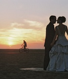 bride and groom kiss at sunset