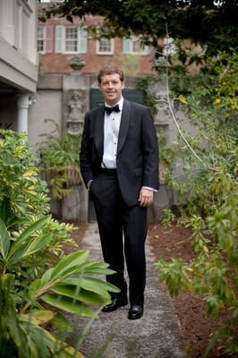 Groom in Savannah, Georgia wearing tuxedo at wedding