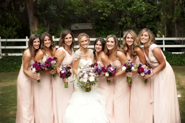 Bride with bridesmaids outside in Malibu, California