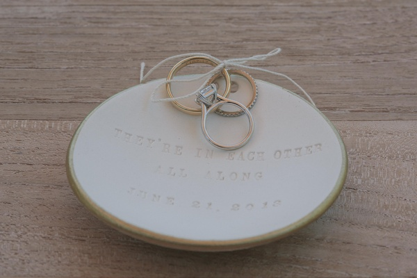rings tied to dish inscribed with poem