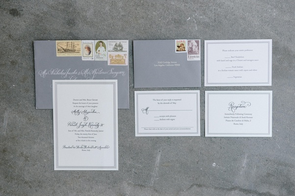 gray envelopes with white invitations