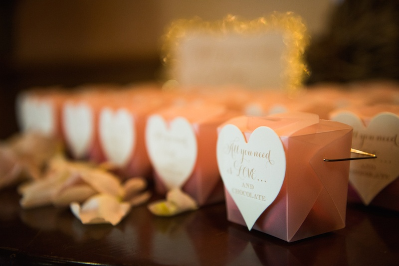 wedding shower with chocolates in pink boxes with heart shaped labels