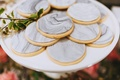 Personalized wedding cookies marble style with hampton in frosting on plate
