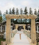 Outdoor wedding ceremony aisle and canopy