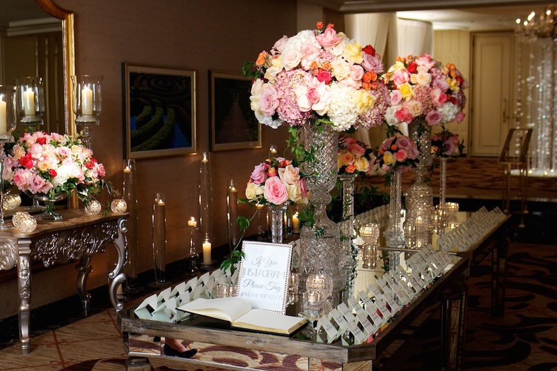 Seating Cards And Crystal Vases On Mirror Tabletop