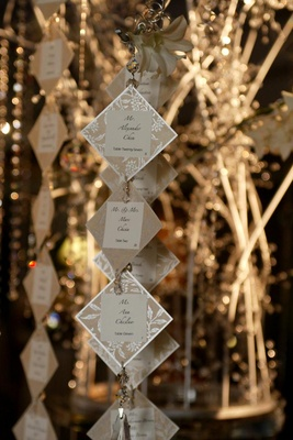 Suspended crystal and metallic seating cards