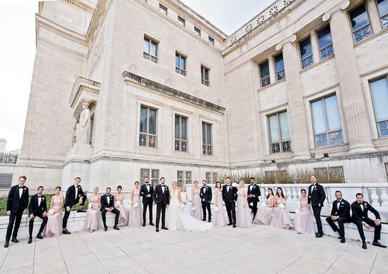 wedding party bridesmaids in light purple dresses groomsmen in tuxedos chicago landmark venue
