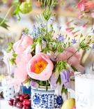 chinoiserie vases, pink and lavender flowers, cherries and pears for decor