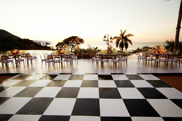 Custom black and white square checker dance floor at wedding