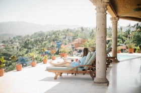 Bridesmaids lounging on terrace with pool destination wedding overlooking Mexico tropical ideas
