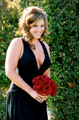 Black bridesmaid dress and red rose bouquet
