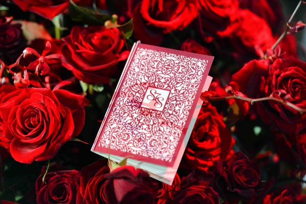 White and red intricate design on hardcover program