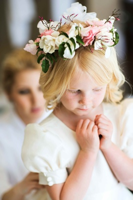 Flower girl with freckles in short sleeve dress with flower headband