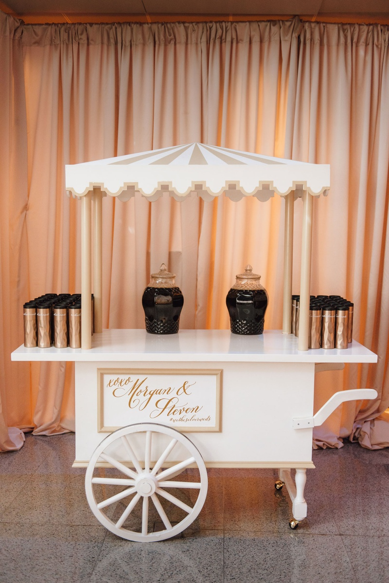 Cute coffee bar cart at wedding reception drapery coffee holder thermos on white cart tray wedding