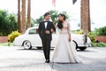 couple walking arm in arm classic tuxedo changes white dress rolls royce wedding california