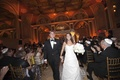 Bride in an A-line Romona Keveza gown exits ceremony with groom in a black tuxedo and bow tie