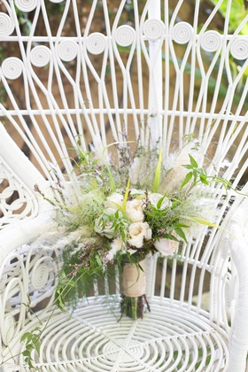 ivory roses with greenery and bits of pampas grass